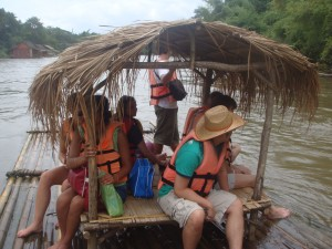 bamboo raft with capacity for ten floating down river in thailand