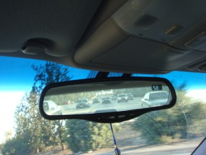 A shocker in the mirror: fleet of cop cars.  Rather intimidating.
