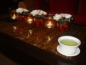 tea and centerpiece with flowers and candles at let's relax spa in phuket thailand