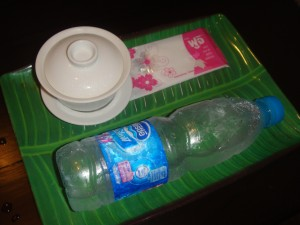 tray with cup of tea, bottle of water, and hand wipe at let's relax spa in phuket thailand