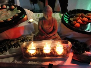 serene scene of mini buddha statue in candlelight