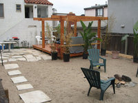backyard garden turned beach paradise, complete with jacuzzi and bonfire pit