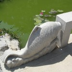 stone fish carved into bridge decoration