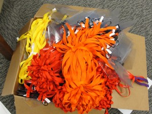 bright clumps of yellow, red, and orange lanyards