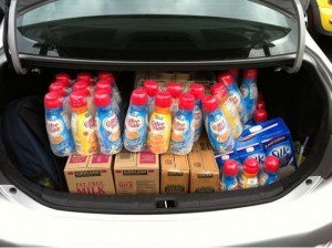 trunk filled with cases of creamer, milk, and other food
