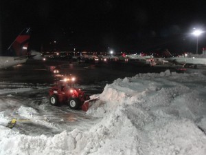 a huge snow bank at jfk airport after a huge blizzard