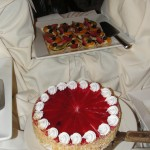 plate of fruit tarts and cake