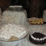 plate of marshmallows, two cakes, and plate of desserts