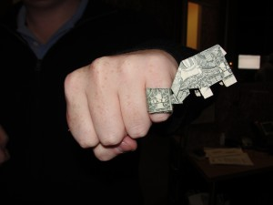 dollar bills folded into ring and elephant