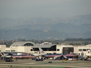 hollywood sign seen in the distance behind lax