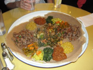 tray of ethiopian food with veggies and tibs