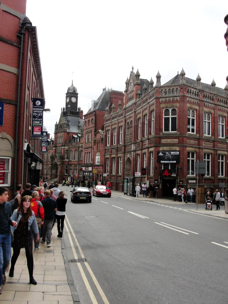clifford street in york with york dungeon entrance and lots of red buildings