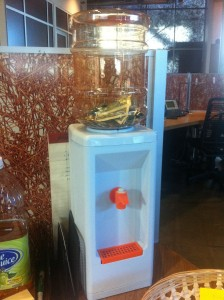 mini water cooler for desktop use repurposed as piggy bank