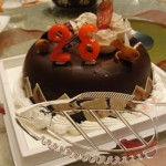 fish-shaped cake cutter and chocolate cake with red candles