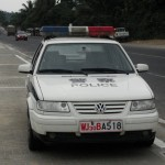 chinese police car parked on side of road