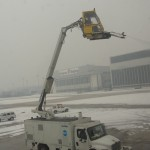 plane getting sprayed by de-icing fluid before takeoff