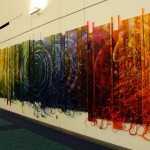 large piece of art by artist james dupree on display at portland aiport