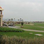 view of shenzhou peninsula golf course, clubhouse, and golf carts