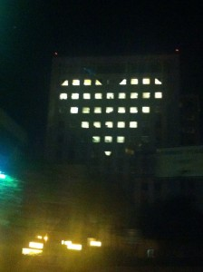 lights in windows of hospital lit up into heart shape
