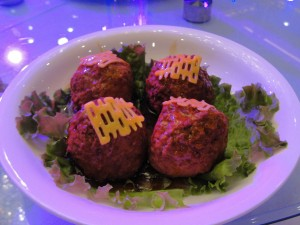 "huge meatballs topped with ""double happiness"" symbol"