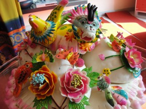 wedding bun or wedding bao made completely of bread molded into dragon, phoenix, fish, and flowers