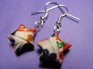 close-up picture of simple origami star earrings