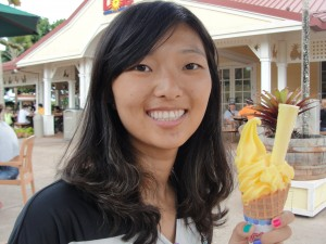 holding a pineapple-flavored ice cream cone at the dole plantation in hawaii