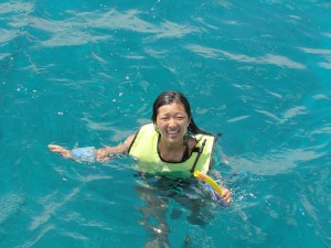 floating in ocean with vest and waterproof camera