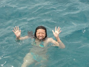 waving while floating in ocean after jumping in
