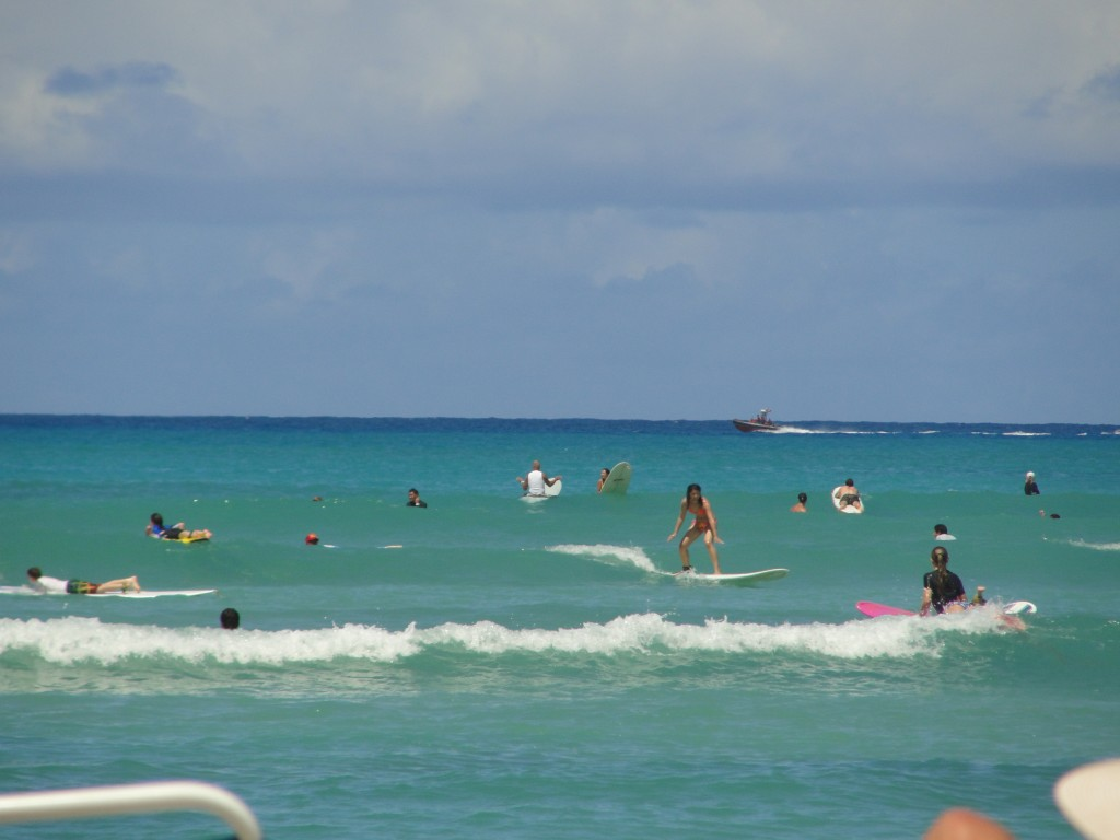 surfing small wave at waikiki beach