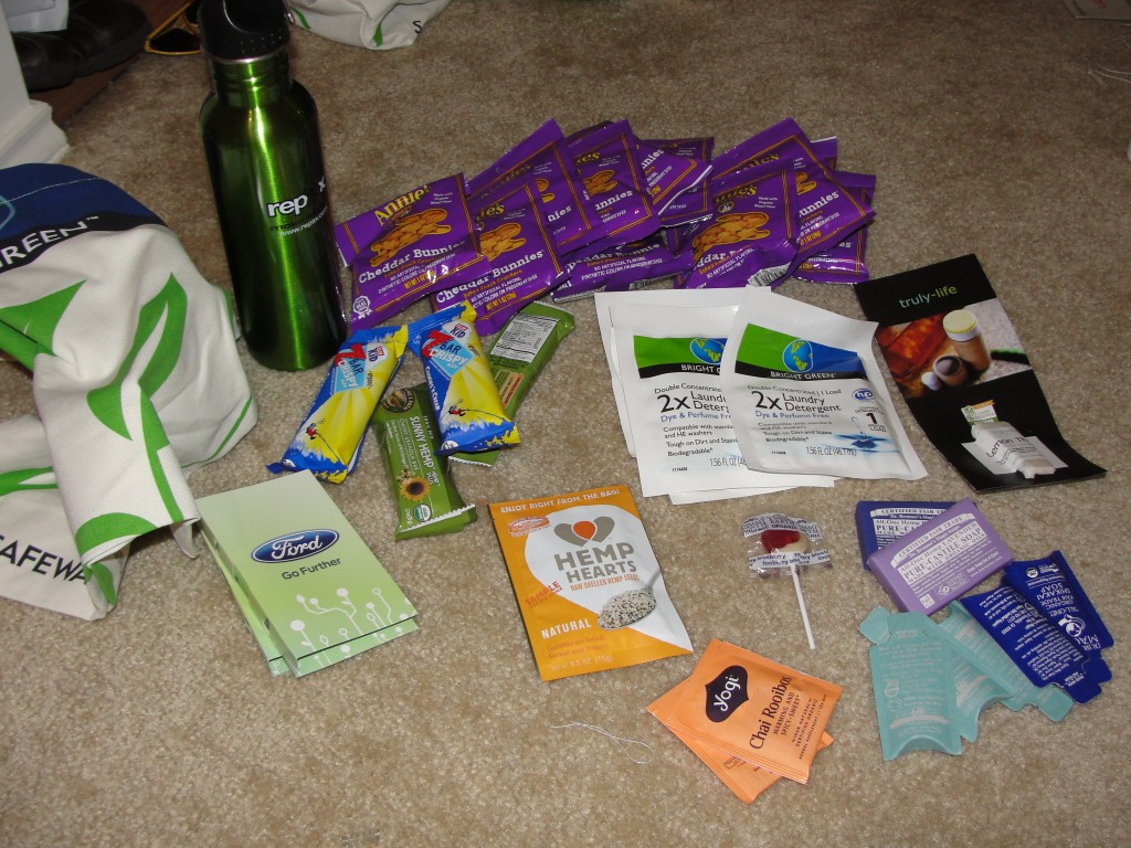 a collection of free things acquired from green festival dc 2012 on day 2