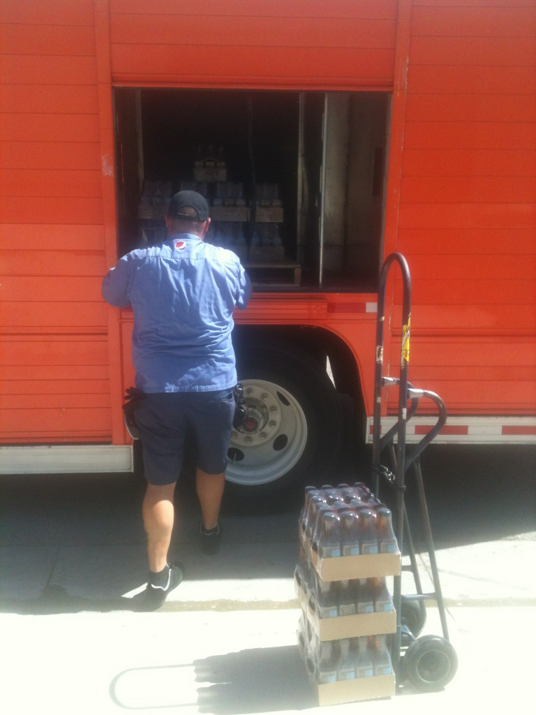 pepsi delivery guy unloads cases of pure leaf tea from his truck