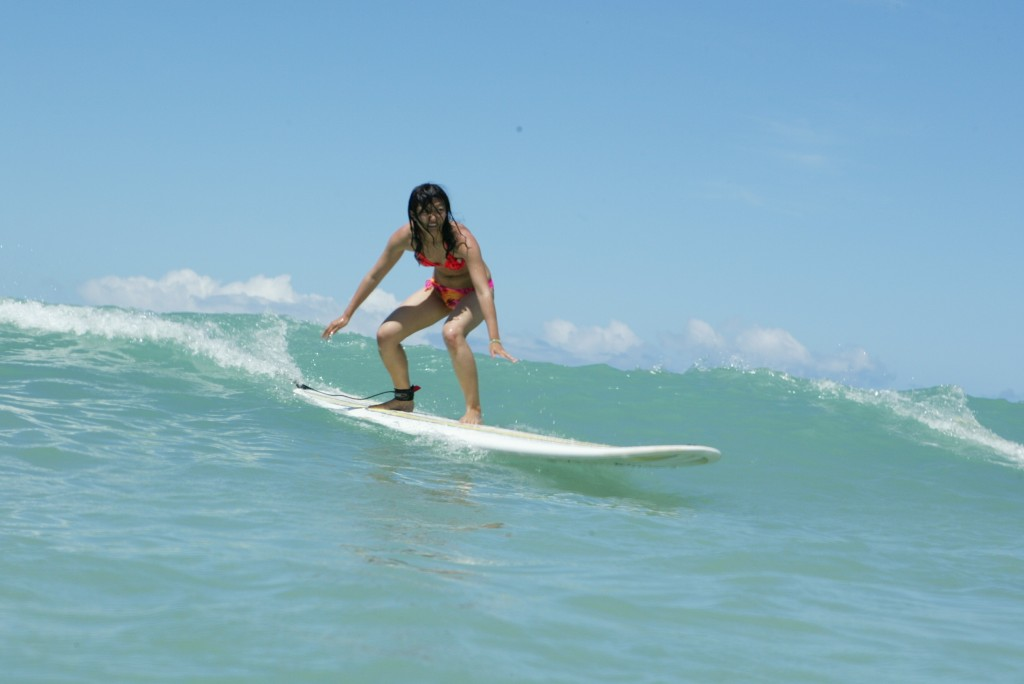 surfing with knees bent for better control