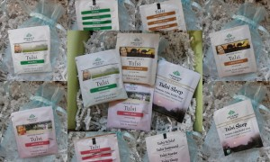 collage of organic india teas included in the august 2012 yuzen box - tulsi original, tulsi lemon ginger, tulsi sweet rose, and tulsi sleep flavors