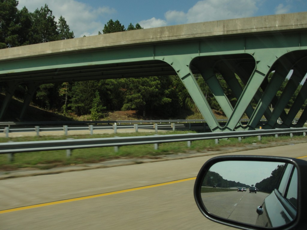 bridge being supported by metal legs forming triangle shape