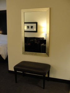 wall mirror and padded bench at w hotel silicon valley