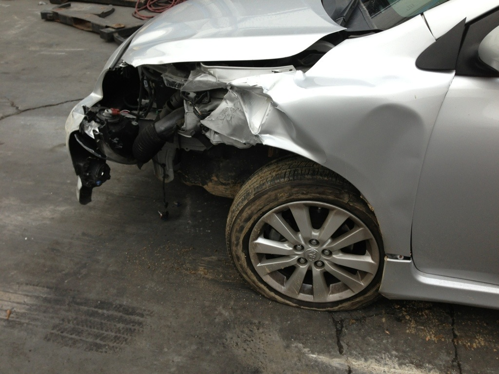the damage to the front left part of the car