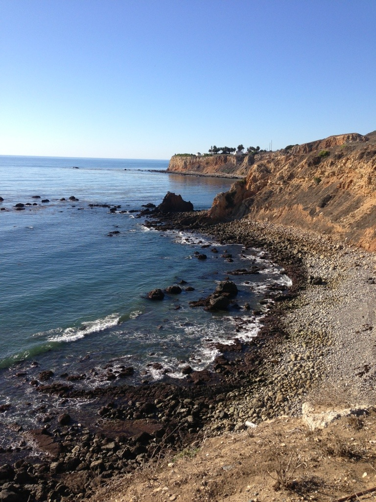 view of rocky beach and red cliffs from terranea resort