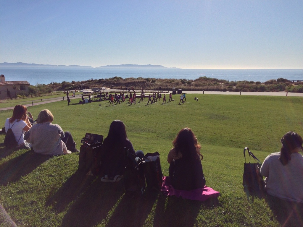 ladies sitting on hillside facing ocean view at terranea during pamper me fabulous event