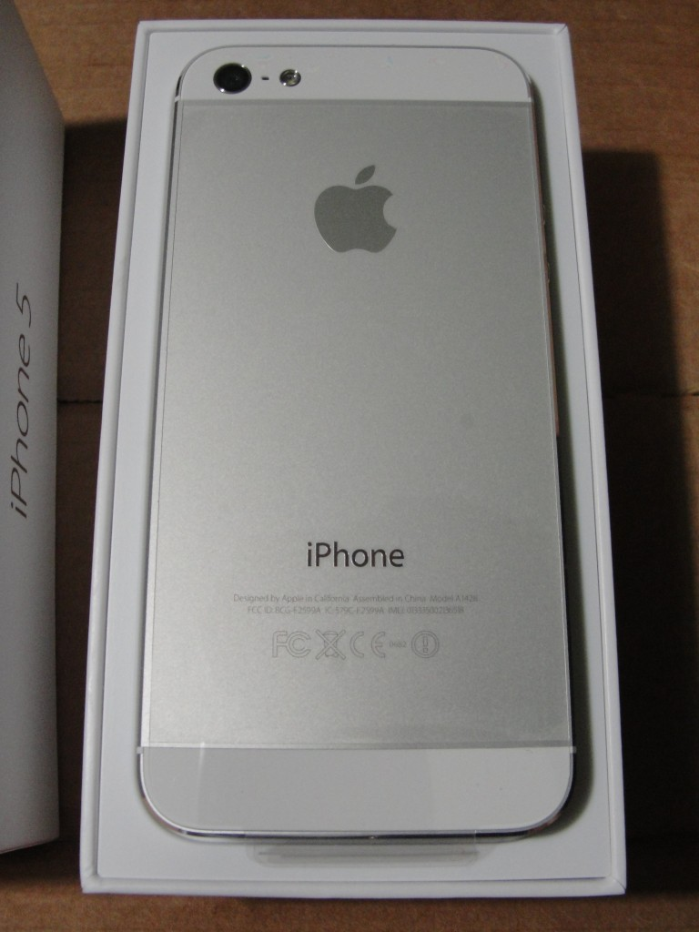 back of white & silver iphone 5 in box