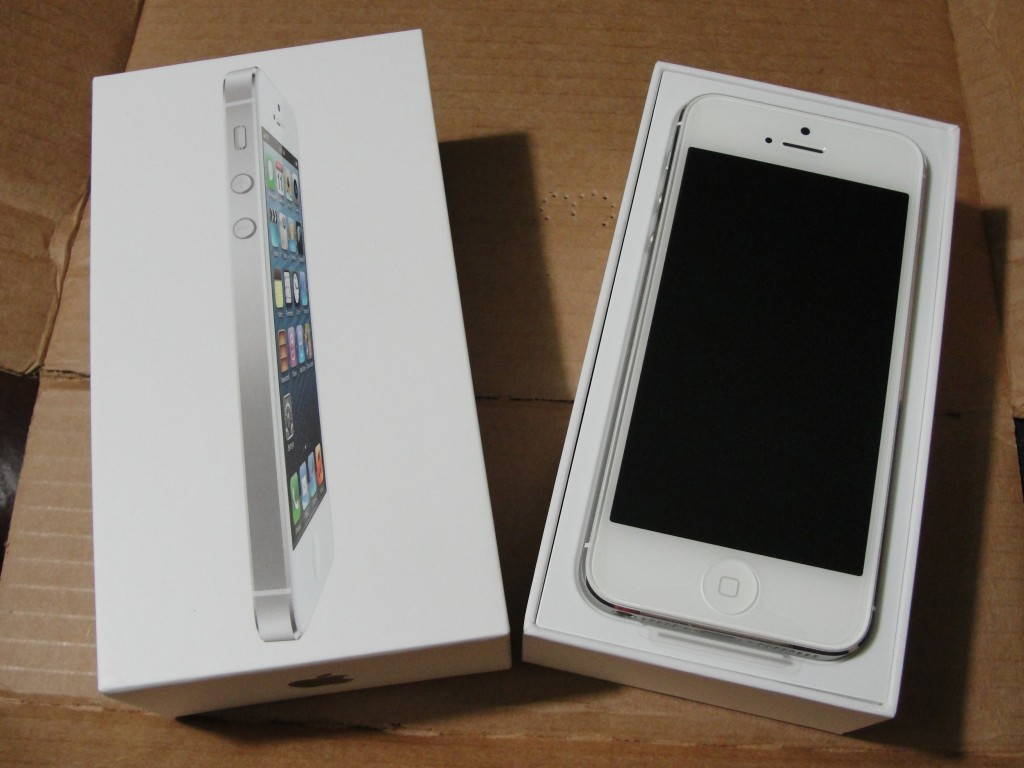 box of white & silver iphone 5 open to reveal phone inside