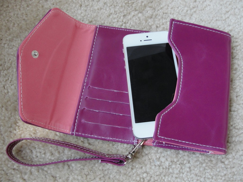white & silver iphone 5 in purple and pink clutch wallet