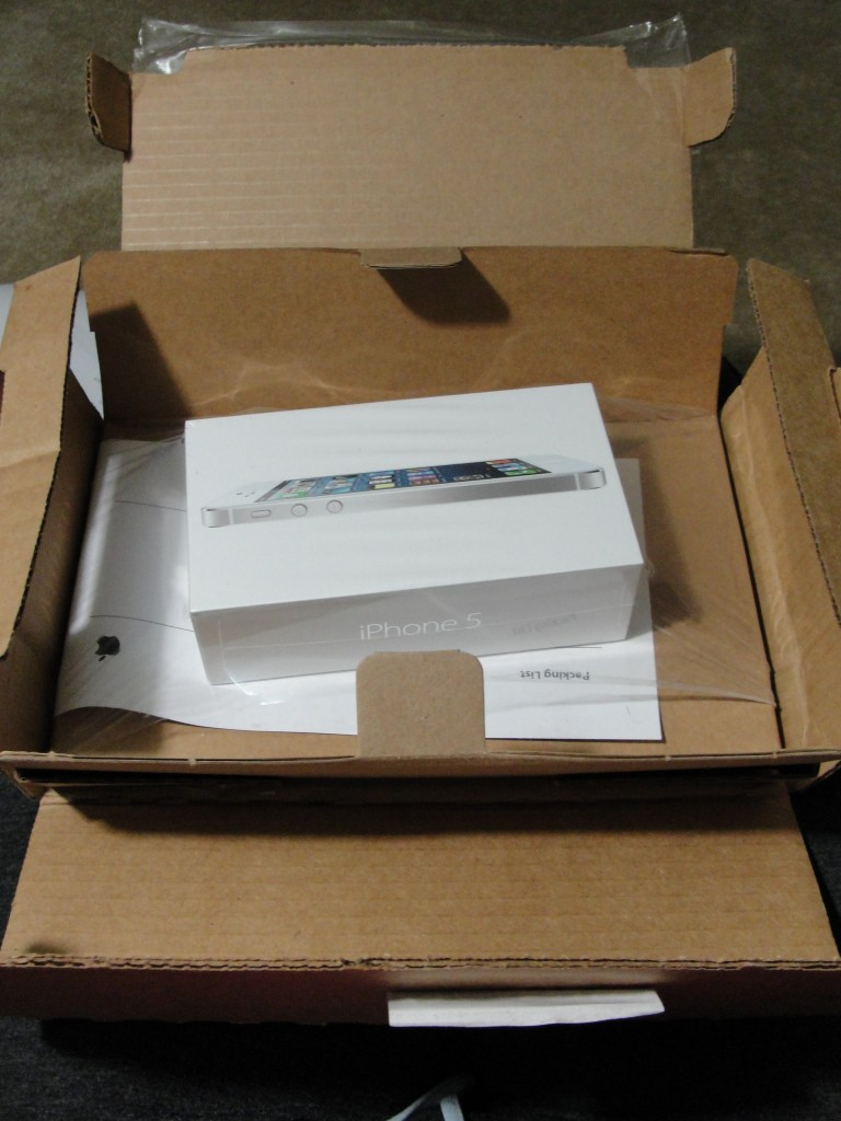 white & silver iphone 5 in shipping packaging