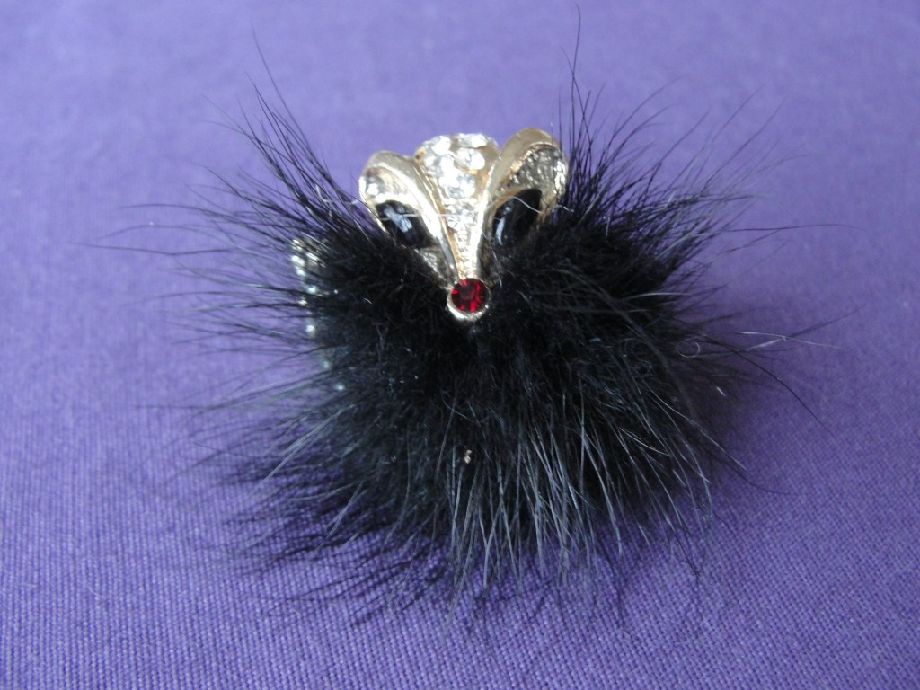 fuzzy black fox ring with gems