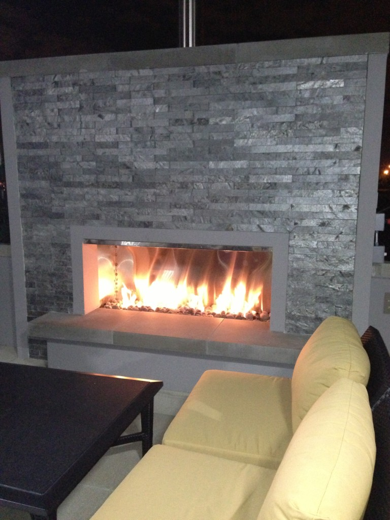 outdoor fireplace with couch seating at hyatt place