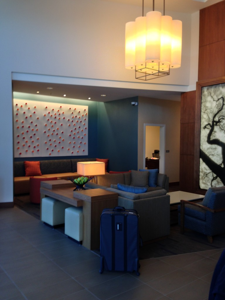 lobby of hyatt place with couches and artwork