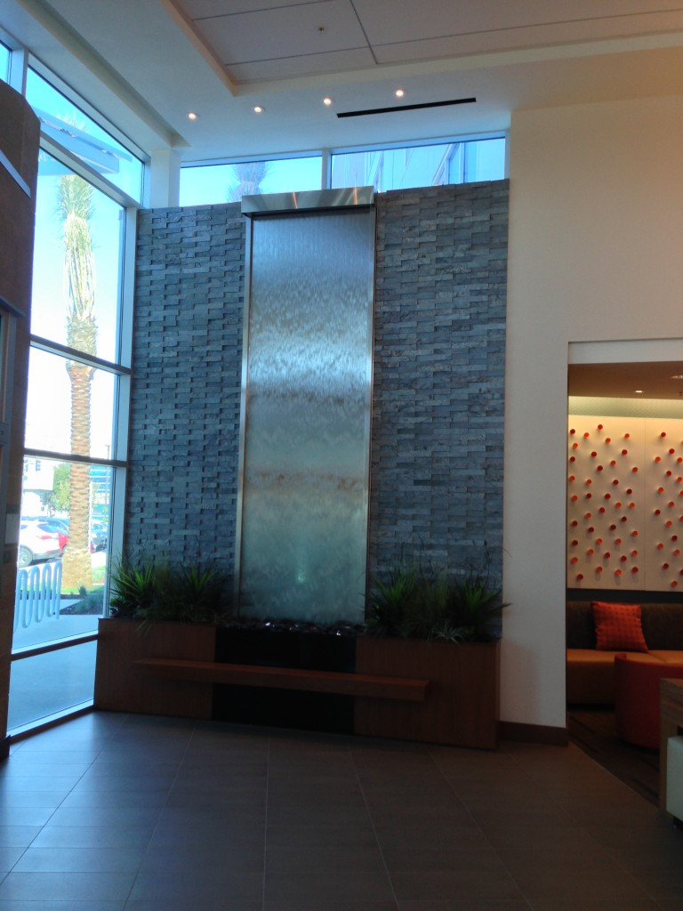 large water wall decoration at entrance of hyatt place
