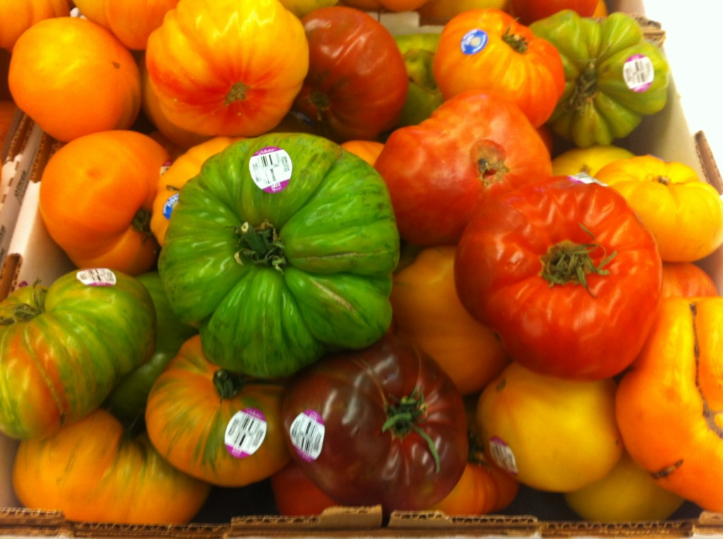 colorful heirloom tomatoes ranging from green to red to yellow to orange at ralph's grocery store