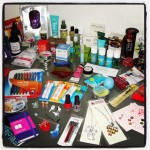 desk displaying tons of home, beauty, stationery, gadgets, accessories, jewelry, bath, and other items