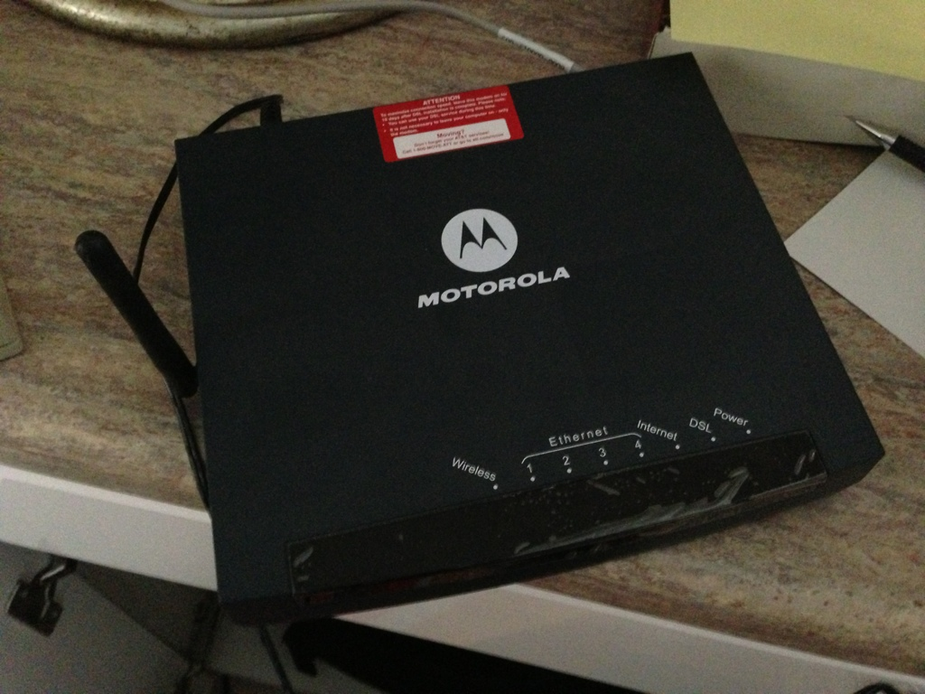 black motorola dsl modem and router box